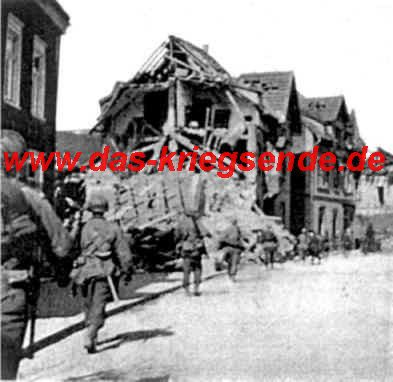 """Bild 12: Bill Parsons, Veteran der 78. US Infantry Division: """"Soldaten der K-Kompanie des 310th Infantry Regiments am 6.4.1945 in der Wilhelmstraße in Betzdorf."""""""